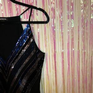 Blue and silver sequined body suit
